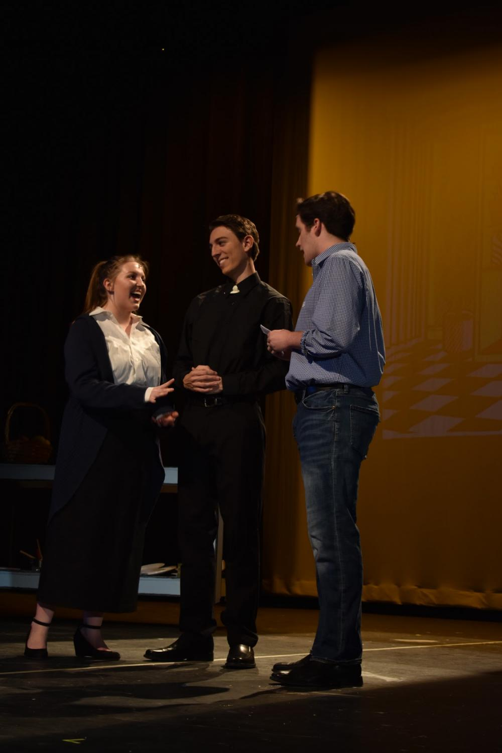Sophie Stapleton, Henry Trochlil, and Jack Powell rehearse for the show (Photo by Riley Draddy)