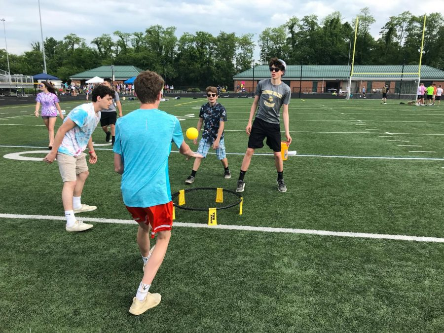 Luke, Evan, Sam, and Xander play a game during field day.