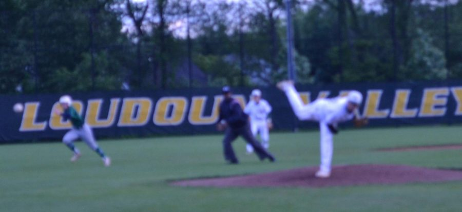 #33 Michael Grupe swiftly threw the ball striking the batter out!