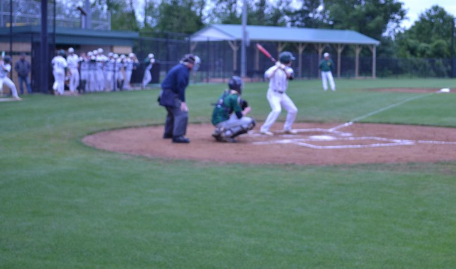 #8 Riley Ashby is ready to hit the ball coming.