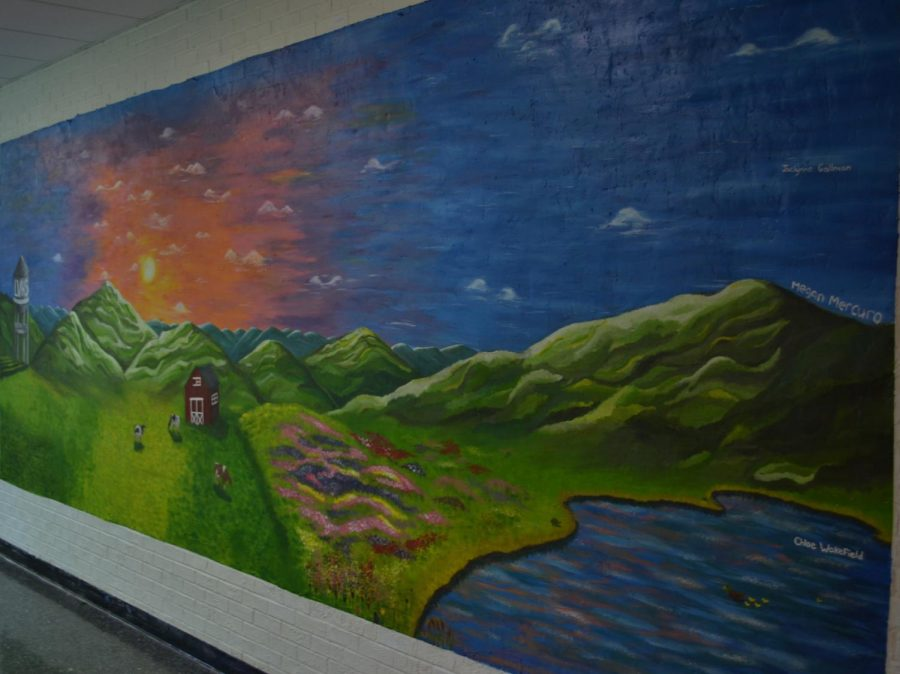 a mural by Jaclynne Gallman, Megan Mercuro, and Chloe Wakefield at the start of the science hall.