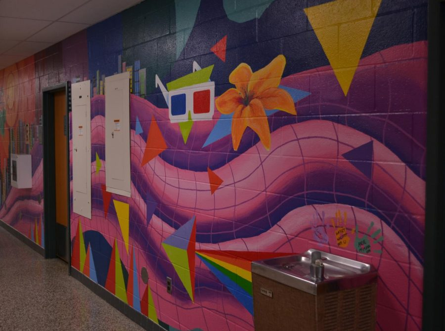 A mural by Hailey Walcott, Andie McCann, and Caleb Peterson.