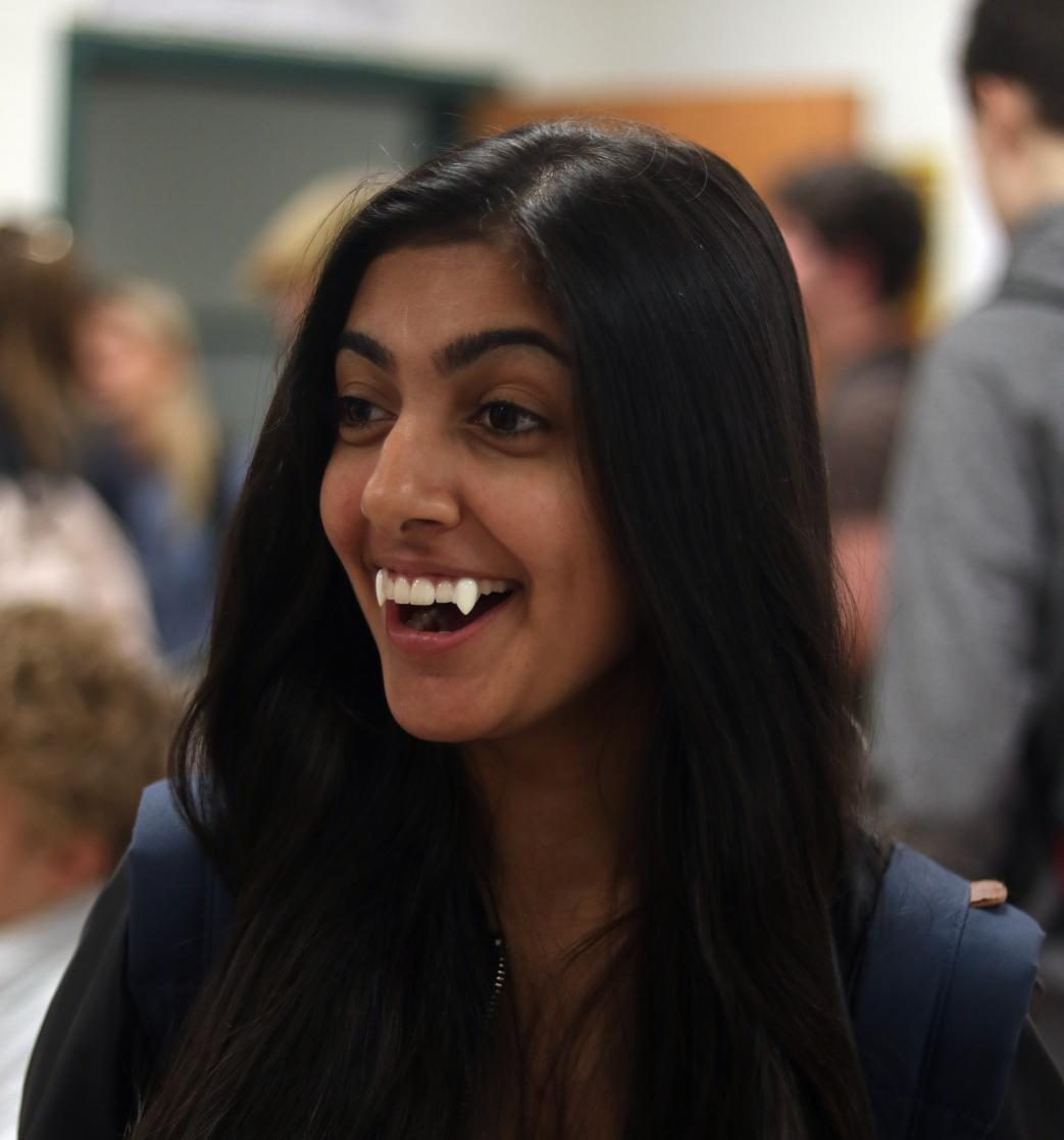 Pooja Kaushal smiles as her fangs fiercely come out of her teeth for the second day of spirit week.