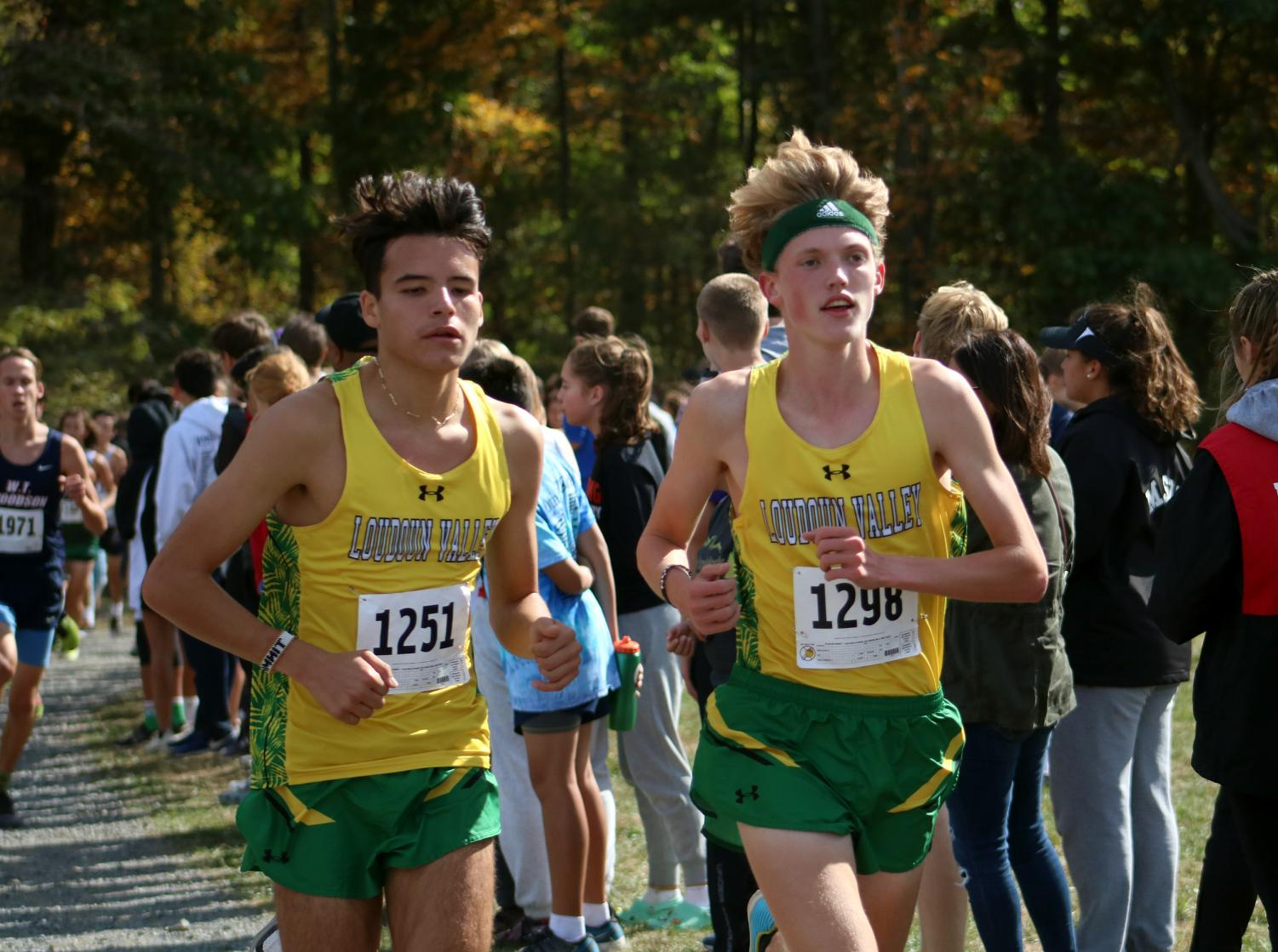 Christian Arellano (left) and Josh Walker (right) run side by side, as they run at the front of the pack, competing in the varsity boys race, at Third Battle.