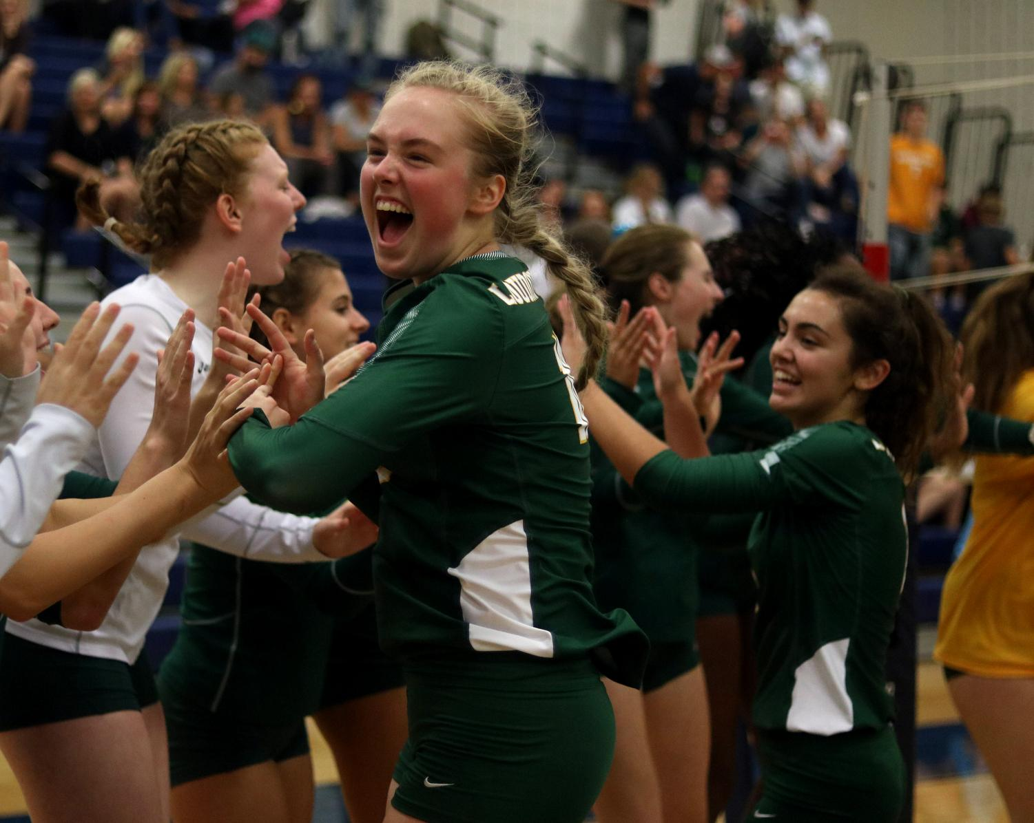 Senior Nicole Steigerwald, high fives all her volleyball teammates, as they beat Woodgrove in a clean sweep on September 12th.