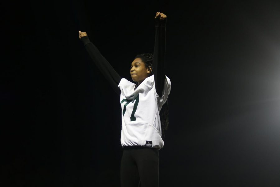 Tirayah Robinson, Varisty cheerleader, prepares to twirl down out of her stunt, during the Heritage game.
