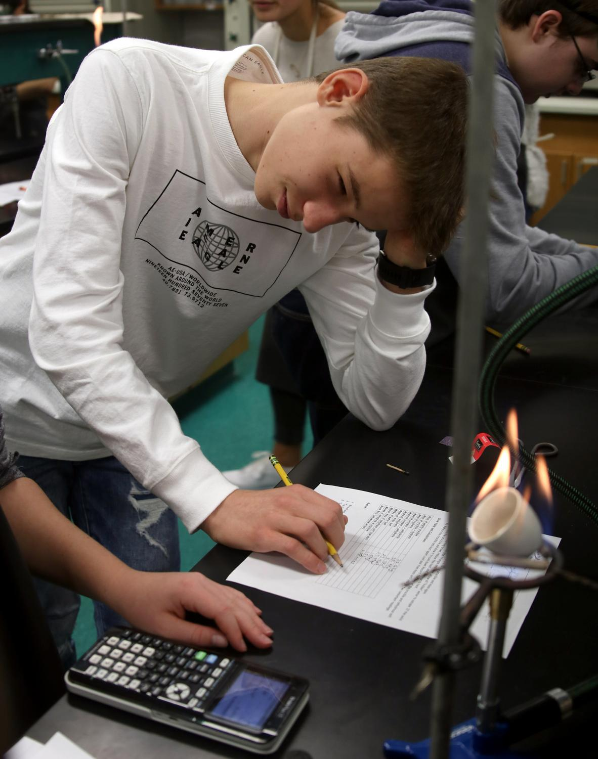 Truman Abbe gets stumped on a question during his hydrate lab in Sunila Bose's chemistry class.