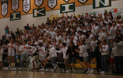 The Loudoun Valley student section, the Jungle, goes wild for Copper Thunell's slam dunk against cross town rival, Woodgrove.