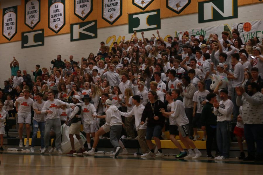 The+Loudoun+Valley+student+section%2C+the+Jungle%2C+goes+wild+for+Copper+Thunell%27s+slam+dunk+against+cross+town+rival%2C+Woodgrove.+