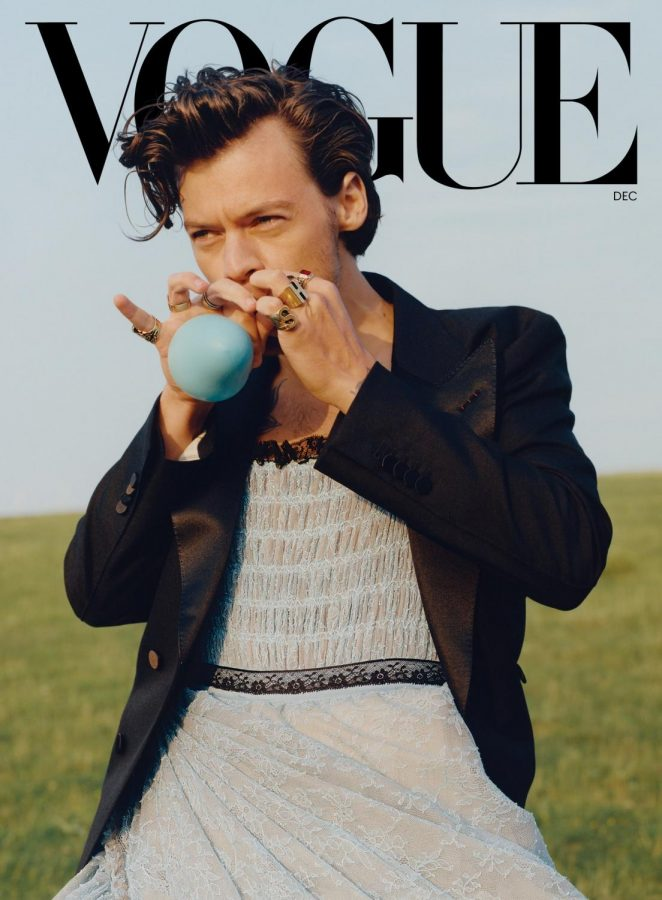 Singer Harry Styles poses on the cover of the December issue of Vogue in a dress, defying clothings gender norms. Photo | Vogue