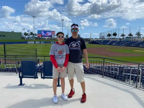 Sage Lin  stands with his father (on the right, Lin on the left) at a Nationals Spring training game last spring prior to Covid-19 lockdown.